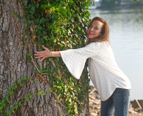 Maria hugging tree